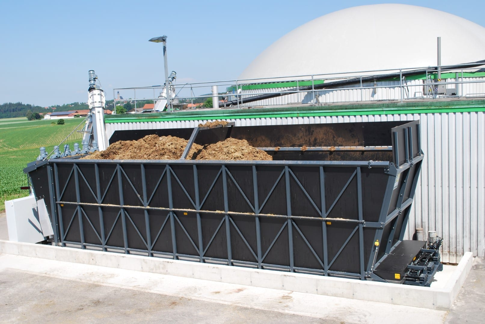 Biogas plant with a big dosing container